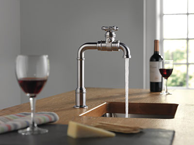 Water flowing out of Broderick Kitchen Faucet in kitchen with wine glasses on the counter