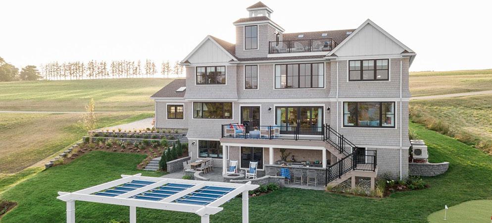 Back exterior of elegant, three-level 2021 HGTV Dream Home